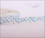 Лента молочная с голубыми цветами